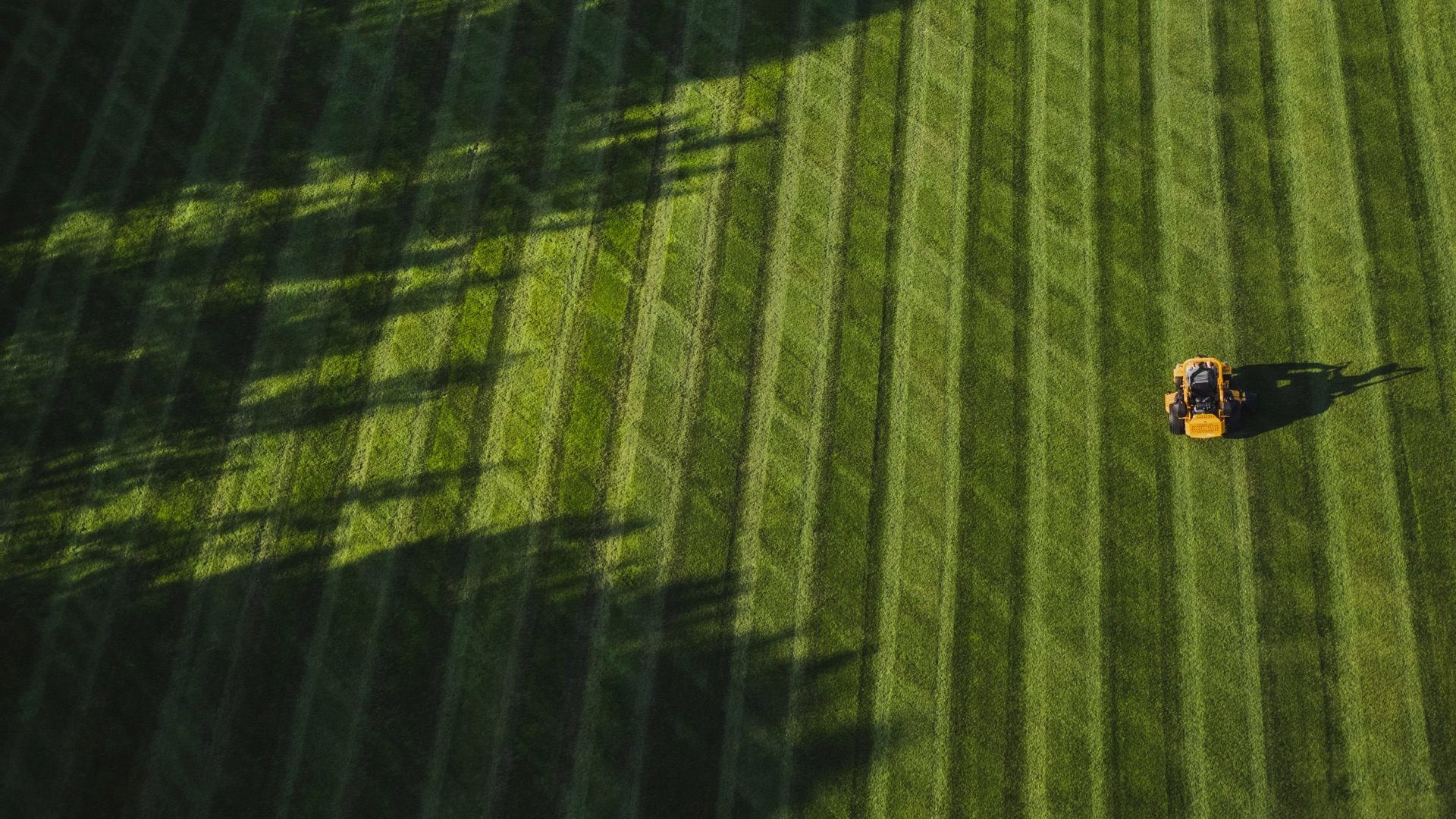 overhead shot of zero turn mower cutting a large space