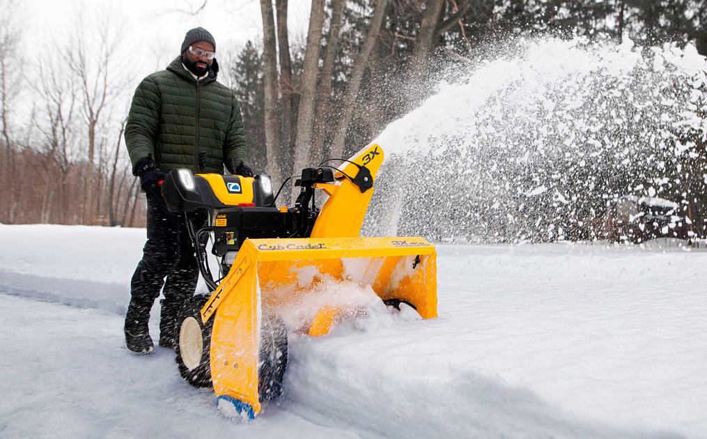 Man snow blowing his driveway