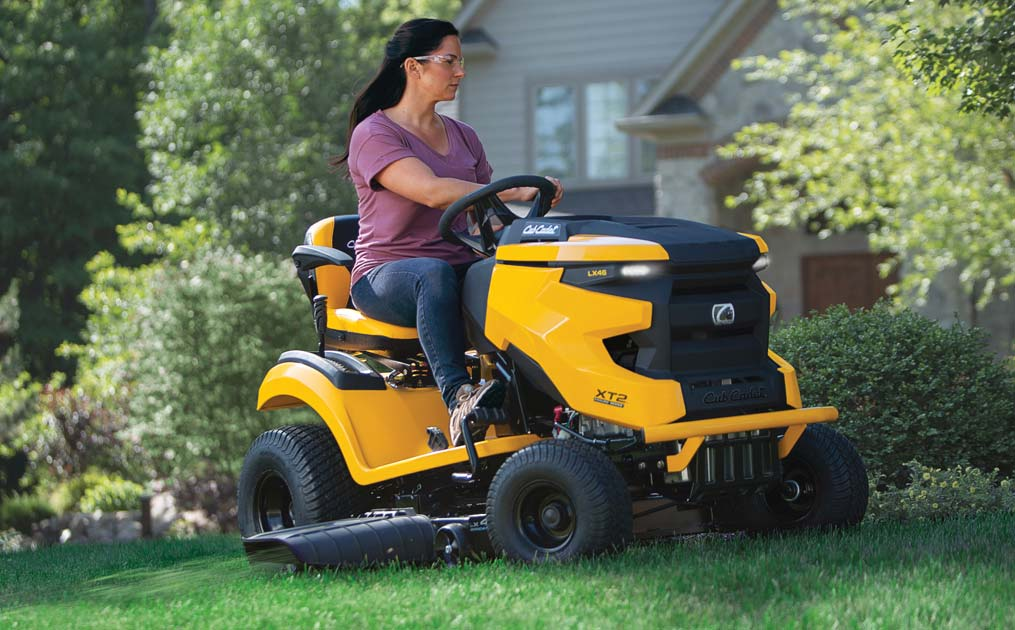 woman cutting lawn with XT2 Riding Mower
