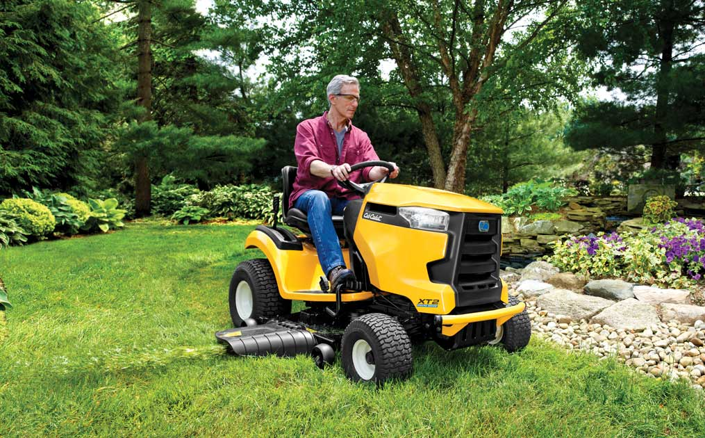 man cutting is lawn with Cub Cadet riding lawn mower