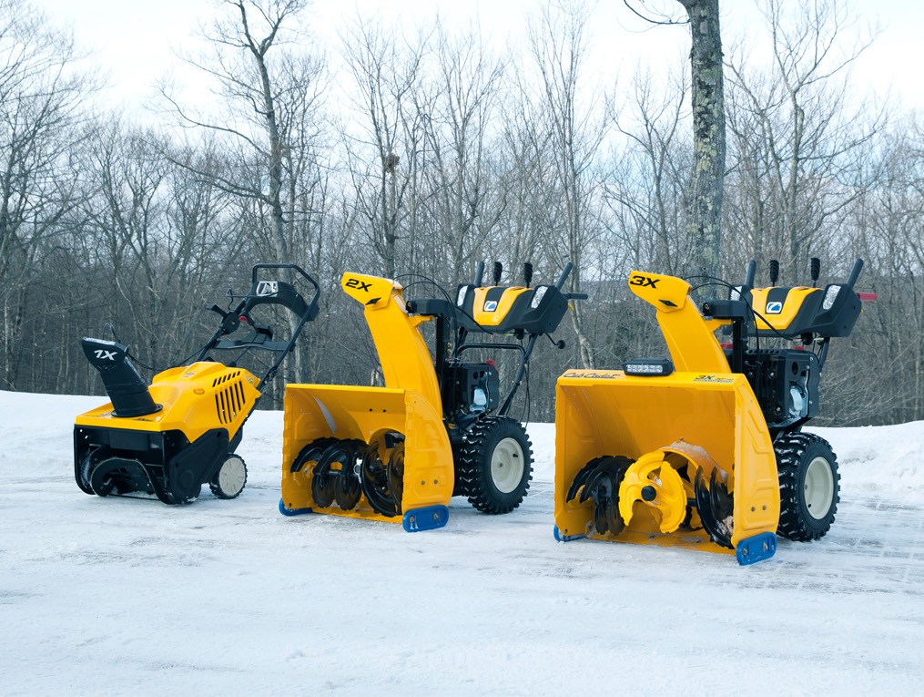 Cub Cadet X series snow blowers lined up in the snow