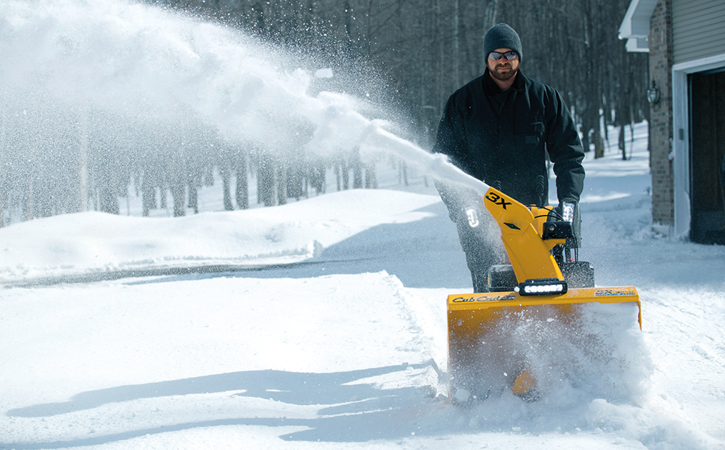 Man snow blowing his driveway