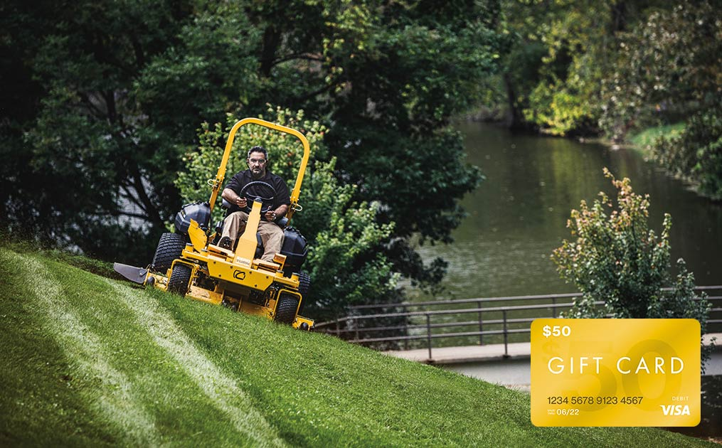 man mowing on pro cub cadet model