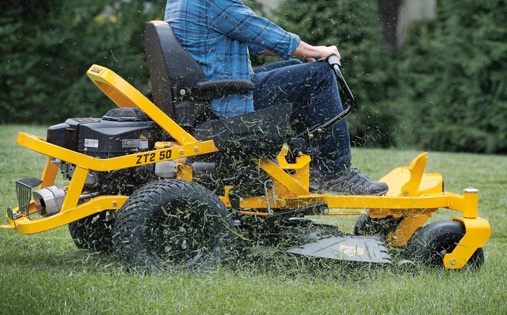 man cutting lawn with Cub cadet Ultima