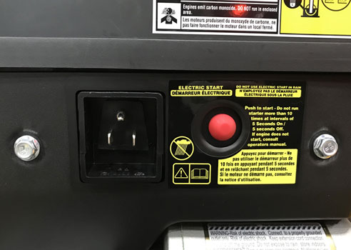 close up of the push button electric start on a cub cadet snow blower