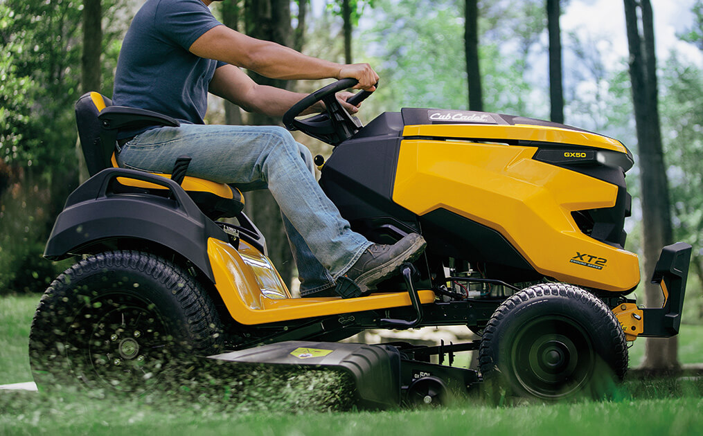 man cutting lawn with new xt2 riding mower